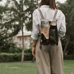 woman wearing handmade leather backpack