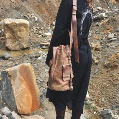 girl with a leather bucket bag and kimono
