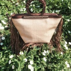 koja braided leather bag and wooden handles with fringes