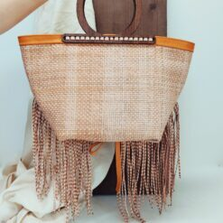 braided leather bag with wooden handles and fringes