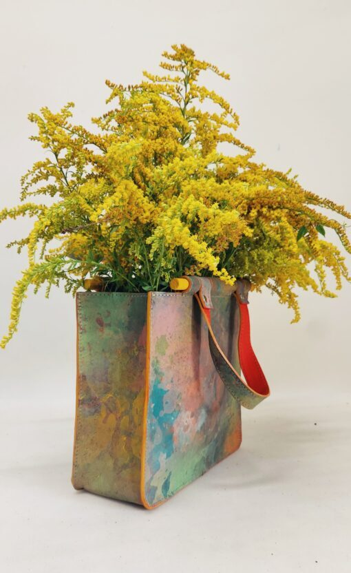 colourful mini leather bag with wooden handles fulll with yellow flowers