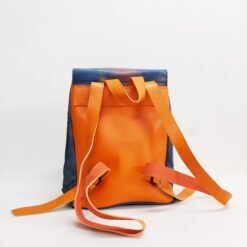 Koja blue and orange leather bakcpack painted in pink, turquoise and copper