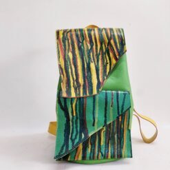 green leather backpack with round base and melted rainbow colours