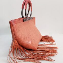 salmon orange braided leather bag with wooden handles and fringes
