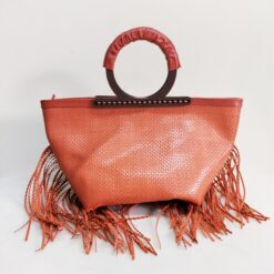 braided leather bag salmon orange with wooden handles and fringes